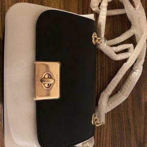 Brand new black Coach purse. Gold chain straps.